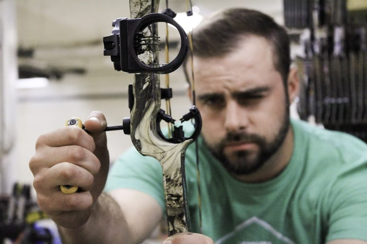Man Attaching Bow Sight