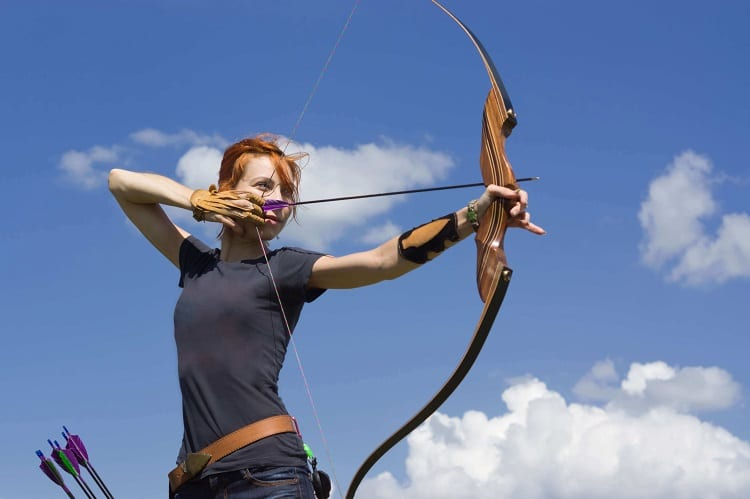 Woman Aiming With Recurve Bow